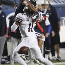 Brigham Young Cougars wide receiver Neil Pau'u (2) tries to catch the ball with defense by Texas State Bobcats safety Zion Childress (11) in Provo on Saturday, Oct. 24, 2020.