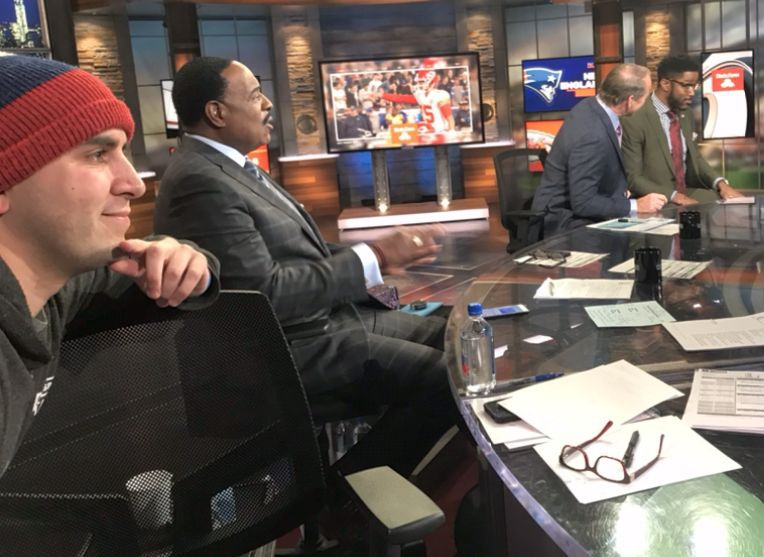 Theo Rabinowitz, far left, with NFL Today host James Brown, and analysts Bill Cowher and Nate Burleson on the CBS set.
