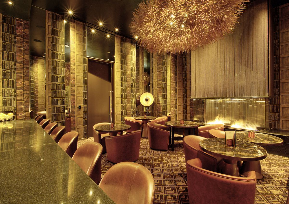 A golden speakeasy with a fireplace