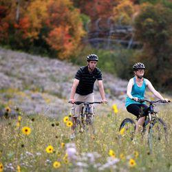 Austin Bridge and Kayela Bridge bike down Park City Mountain Resort in Park City on Friday, Sept. 5, 2014.
