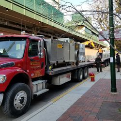 Trucks taking event equipment out of Wrigley