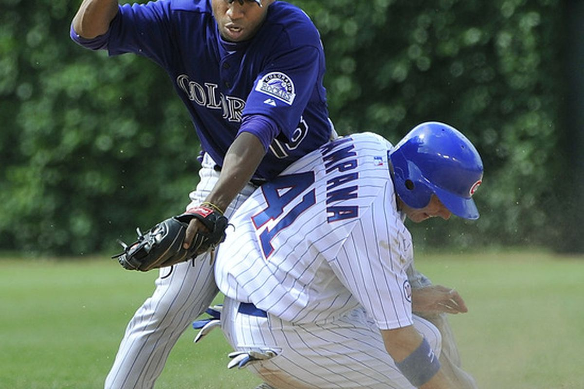 Tony Campana of the Chicago Cubs steals second base as second baseman Jonathan Herrera of the Colorado Rockies tries to make a tag during the sixth inning at Wrigley Field on June 27, 2011 in Chicago, Illinois.  (Photo by Brian Kersey/Getty Images)