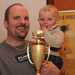 Jason Harrison of Flame celebrating the win with his son