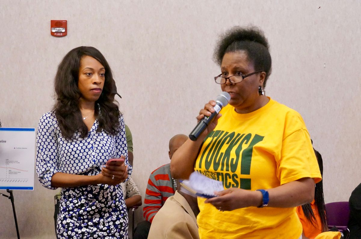 Carrie Harris, right, was one of several Indianapolis Public Schools alumni who criticized the district proposal to close three high schools.