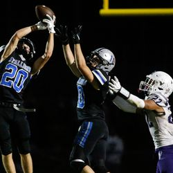Stansbury's Dylan Hamilton (20) attempts a pass during a high school football game against Tooeleat Stansbury High School in Stansbury Park on Friday, Sept. 17, 2021.