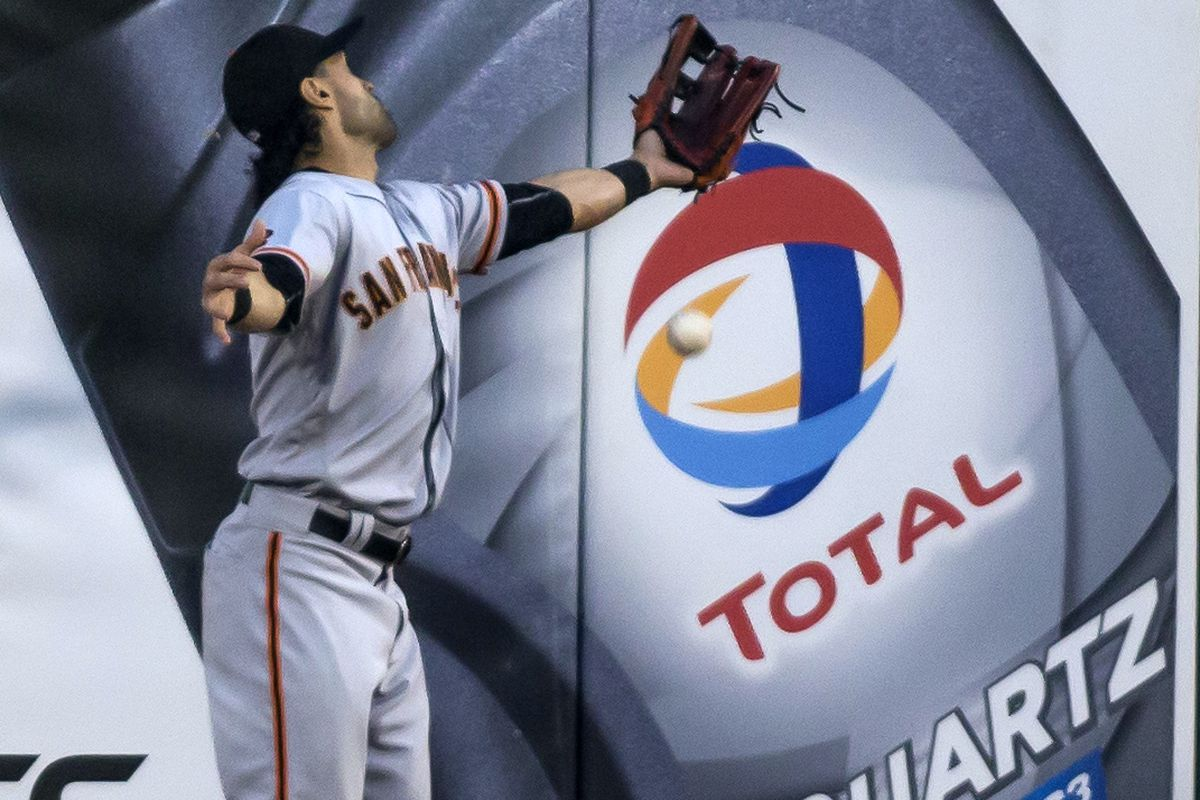 Angel Pagan reacts to a ground ball hit to first base.