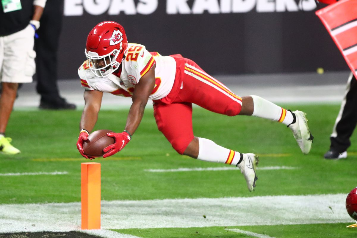 Kansas City Chiefs running back Clyde Edwards-Helaire (25) dives across the goal line to score a touchdown in the third quarter against the Las Vegas Raiders at Allegiant Stadium.