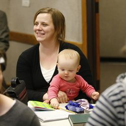 Courtney Williams holds her daughter, Grace, as 18-30-year-old students meet during a Pathway gathering in Orem on Feb. 16, 2017. Pathway is a pre-college, low-cost bridge to higher education.