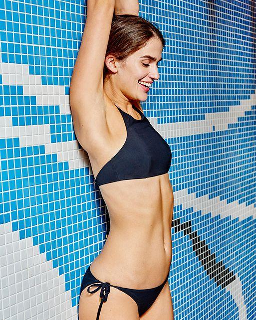 A black bikini against blue tile