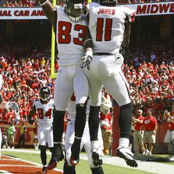 Atlanta Falcons wide receiver Julio Jones (11) celebrates his touchdown with teammate Harry Douglas (83) during the first half of an NFL football game against the Atlanta Falcons at Arrowhead Stadium in Kansas City, Mo., Sunday, Sept. 9, 2012.