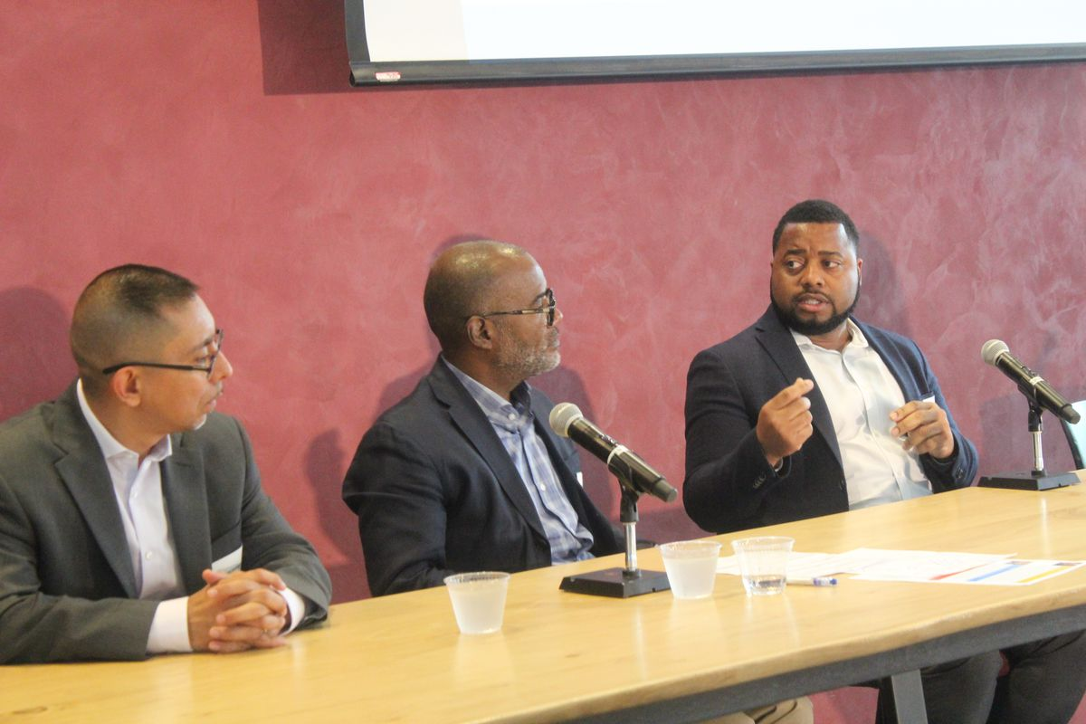 Chicago Public Schools' Chief Equity Officer, Maurice Swinney (far right), spoke on a panel about addressing trauma in youth. Also pictured, from left, are panelists Eddie Bocanegra and Bryan Samuels.