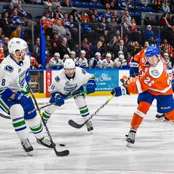 Syracuse Crunch Ross Colton (22) fires the puck past Utica Comets Dylan Blujus (8) in American Hockey League (AHL) action at the War Memorial Arena in Syracuse, New York on Saturday, December 28, 2018. Syracuse won 10-1. © Scott Thomas Photography