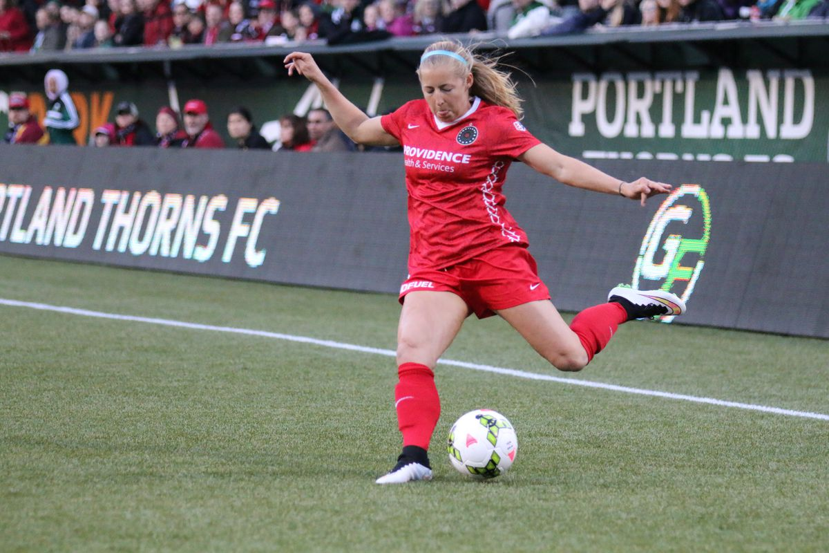 Midfielder Kendall Johnson gets a cross into the box during a 4-1 win over the Boston Breakers in the Portland Thorn's 2015 NWSL season opener at Providence Park on April 11, 2015