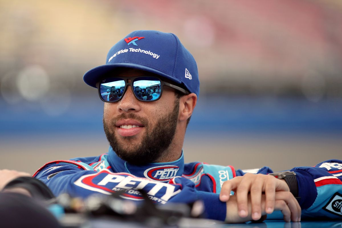 Bubba Wallace, driver of the #43 Victory Junction Chevrolet, stands by his car before qualifying for the NASCAR Cup Series Auto Club 400 at Auto Club Speedway on February 29, 2020 in Fontana, California.