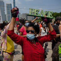 Dorothy Glasper dances with the crowd during a march that commemorates Juneteenth in downtown Chicago on June 19, 2020.