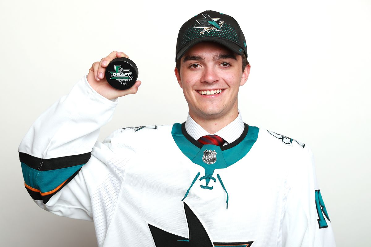 DALLAS, TX - JUNE 22: Ryan Merkley poses after being selected twenty-first overall by the San Jose Sharks during the first round of the 2018 NHL Draft at American Airlines Center on June 22, 2018 in Dallas, Texas.