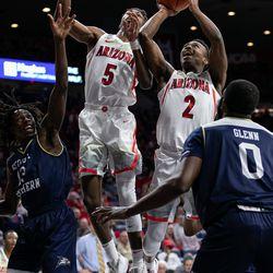 Arizona's Brandon Williams (2) shoots through heavy defense as Brandon Randolph (5) jumps to finish the play during the Arizona-Georgia Southern game in McKale Center on November 29 in Tucson, Ariz.