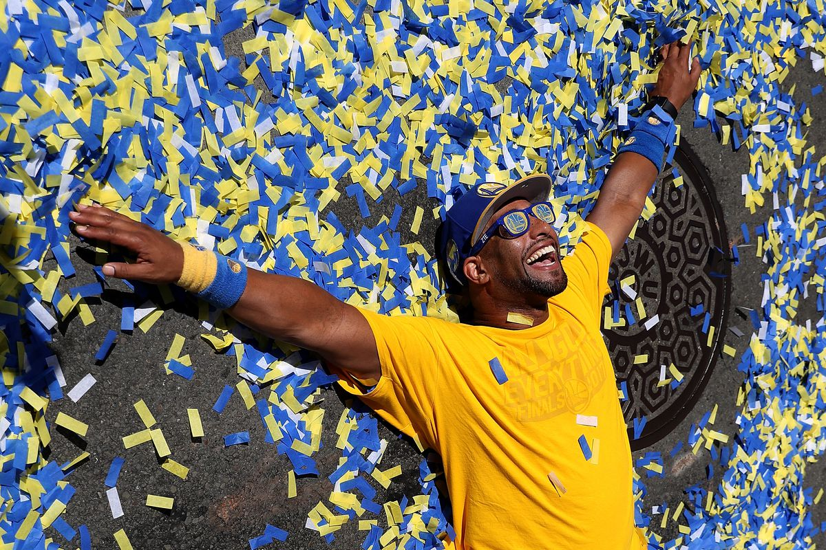 A Golden State Warriors Fan Makes Snow Angels In Confetti During The  Warriors Victory Parade Photo By Justin Sullivan Getty Images
