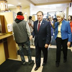 Gov. Gary R. Herbert walks with homeless advocate Pamela Atkinson into the Fourth Street Clinic to sign two bills — HB436 and HB437 — in Salt Lake City on Friday, March 25, 2016. HB346 will pump $9.25 million into homeless services and shelters, the first of three years of funding that should eventually amount to $27 million. HB347 will provide $15 million to expand Medicaid coverage to the state's poorest of the poor.