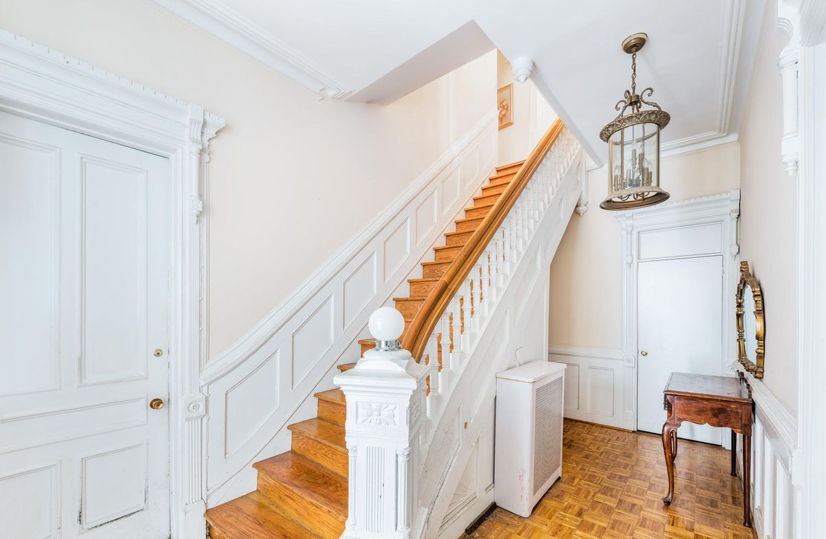 A staircase with a balustrade and newel post.