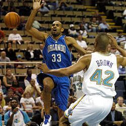 Orlando's Grant Hill (33) looses the ball in front of Hornets' P.J. Brown Thursday night.