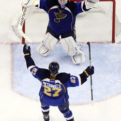 St. Louis Blues defenseman Alex Pietrangelo (27) celebrates with goaltender Brian Elliott as time expires against the San Jose Sharks in Game 5 of an NHL Stanley Cup first-round hockey playoff series, Saturday, April 21, 2012, in St. Louis. The Blues won 3-1 and won the series 4-1.