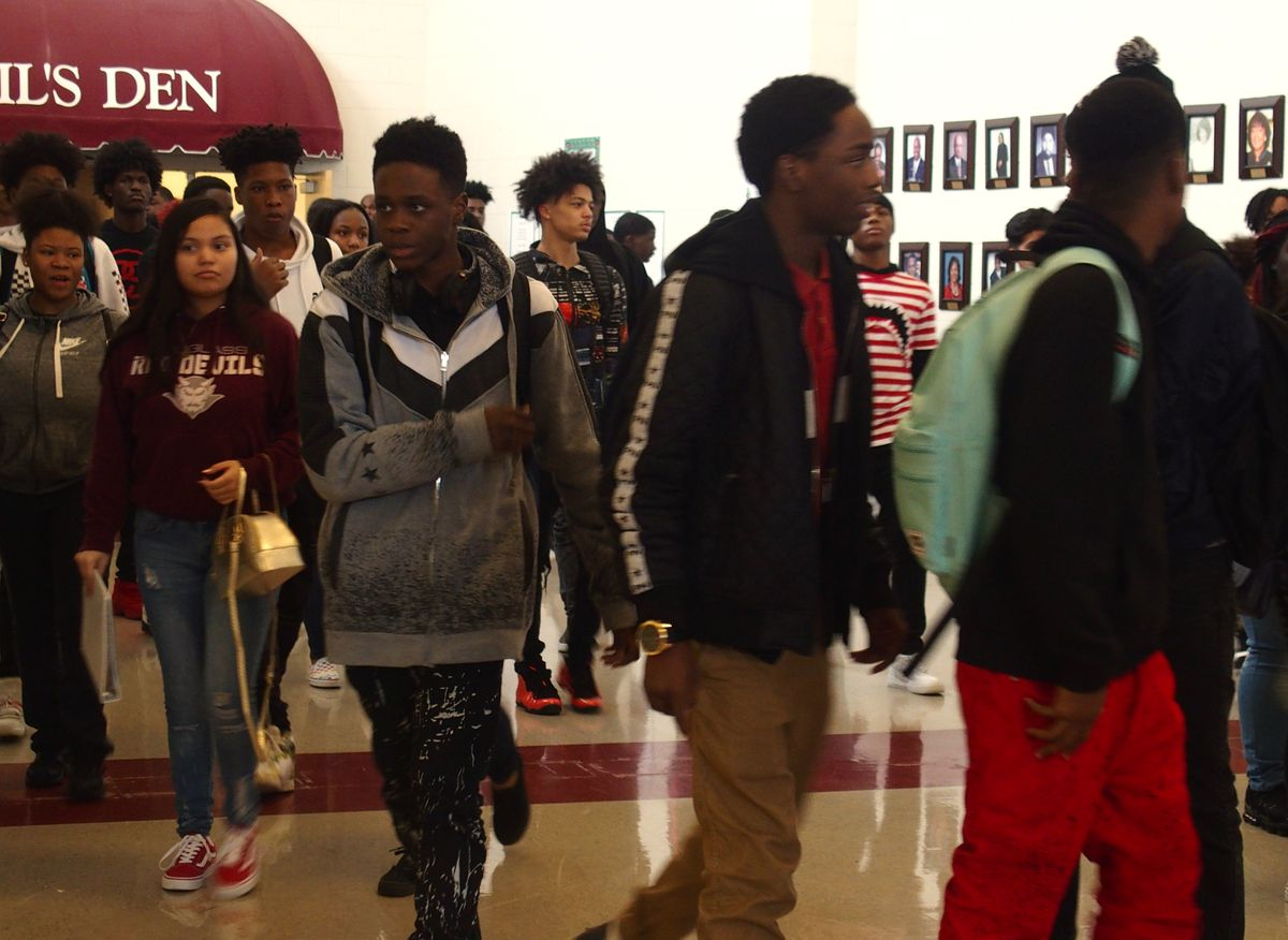 Students walk to class at Douglass High School, part of the Innovation Zone, a school turnaround program in Memphis and Shelby County Schools.
