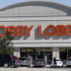 Customers walk into a Hobby Lobby Thursday, Nov. 1, 2012, in Dallas.