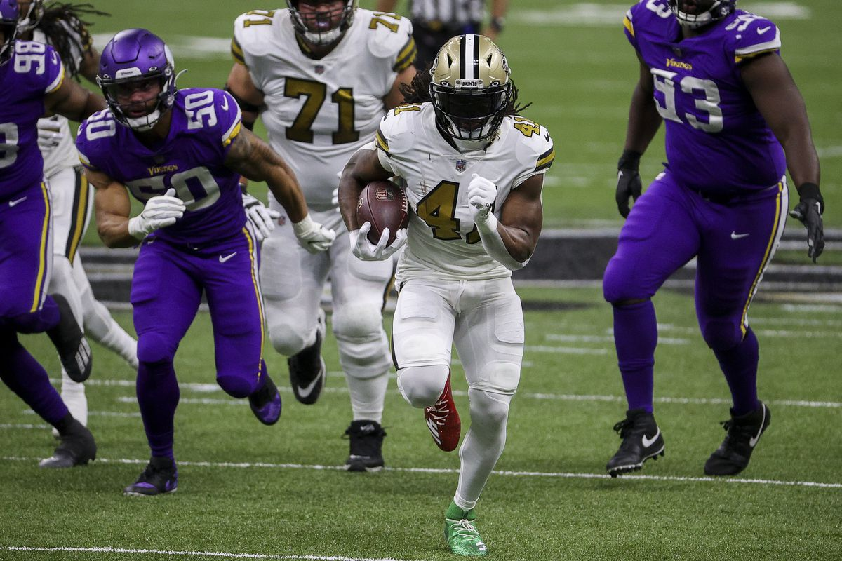 Alvin Kamara #41 of the New Orleans Saints carries the ball during the first quarter against the Minnesota Vikings at Mercedes-Benz Superdome on December 25, 2020 in New Orleans, Louisiana.