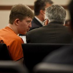 Matthew David Stewart talks with an attorney during the third day of his preliminary hearing at 2nd District Courthouse in Ogden on Friday, Nov. 2, 2012.