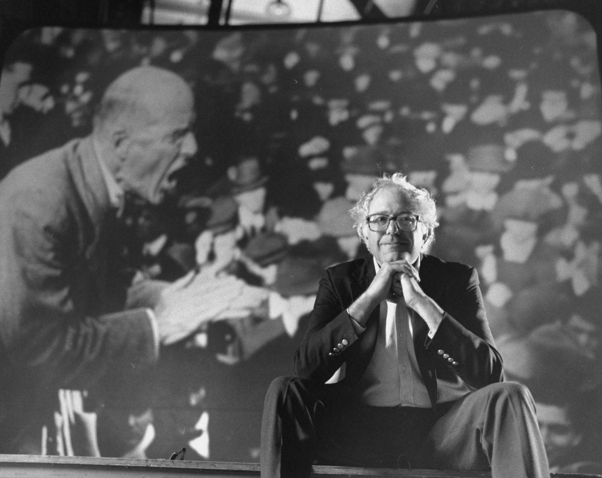 Bernie Sanders sits in front of an image of socialist leader Eugene V. Debs in 1990.
