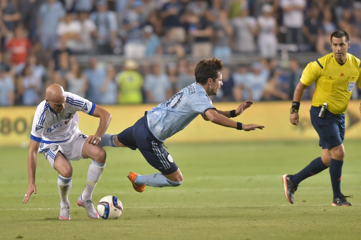 Ciman attempts a tackle on KC's Benny Feilhaber on Saturday night.