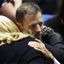 Injured Ogden Police Officer Shawn Grogan hugs a well-wisher prior to funeral services for Ogden Police Officer Jared Francom in Ogden Wednesday, Jan. 11, 2012. Francom, a seven-year veteran of the force, was killed in the line of duty on Jan. 4, while serving a warrant. Five other law enforcement agents were wounded on the scene.
