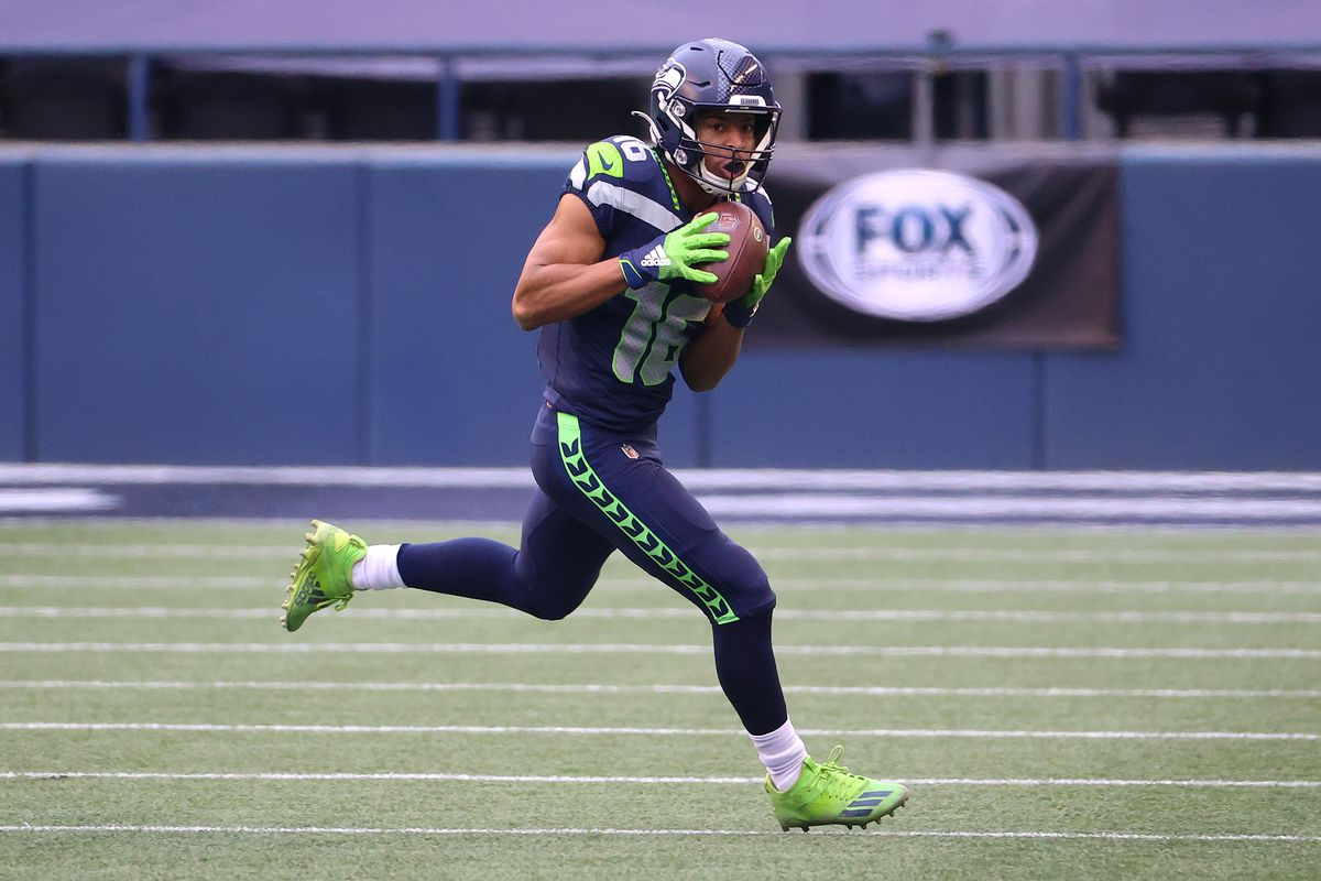 Tyler Lockett #16 of the Seattle Seahawks runs with the ball in the second quarter against the Los Angeles Rams during the NFC Wild Card Playoff game at Lumen Field on January 09, 2021 in Seattle, Washington.