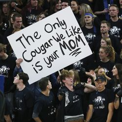 Utah State Aggies fans hold a sign in Logan on Saturday, Dec. 2, 2017.
