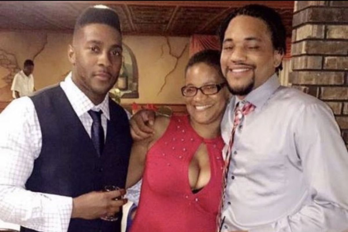 Illinois State Police Trooper Gerald Mason (left) with his mother Linda Mason and brother Markise Wilson.