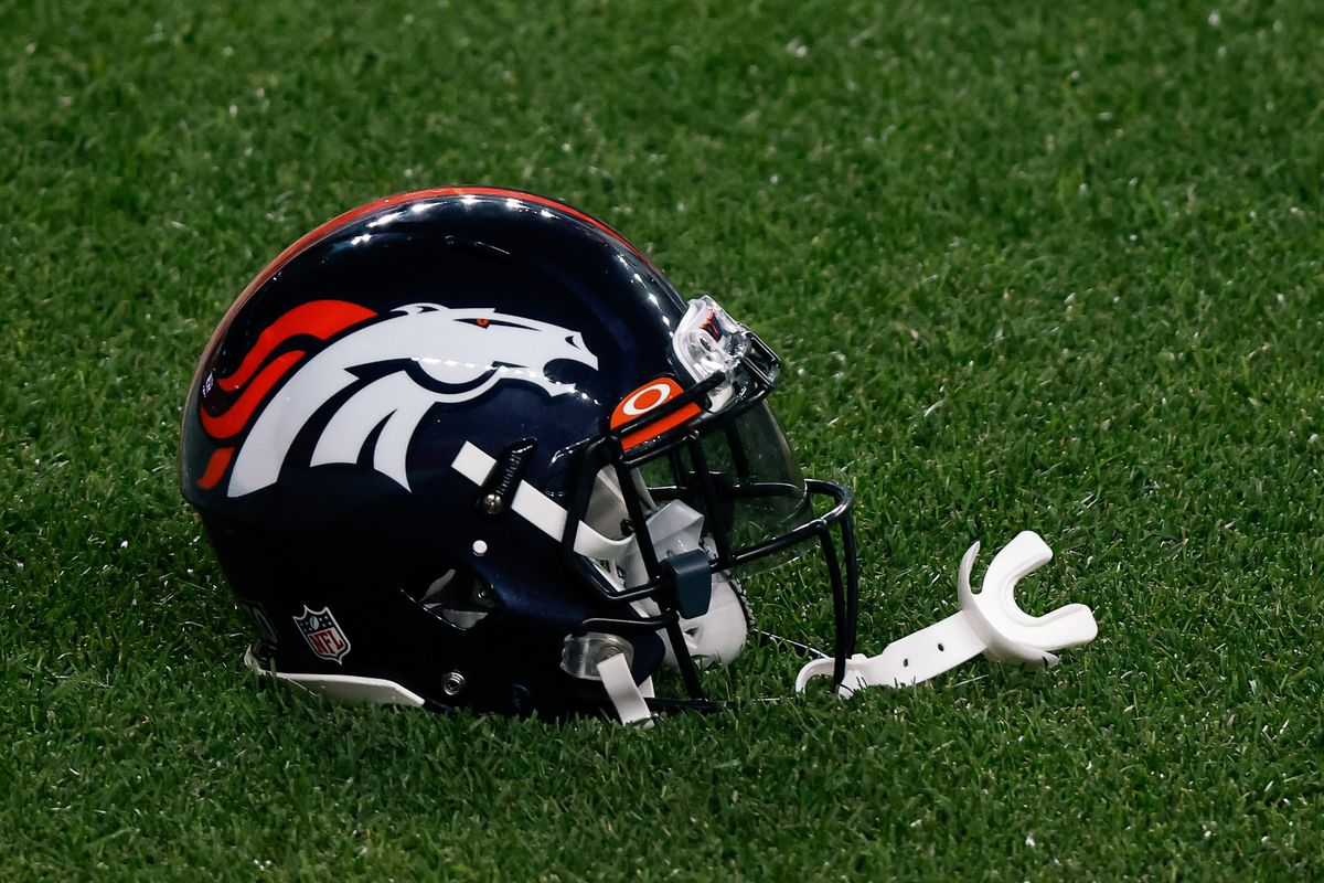A Denver Broncos helmet on the ground before the game against the Tennessee Titans at Empower Field at Mile High.