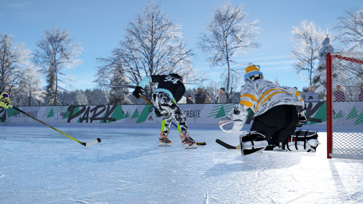NHL 20 screenshot of an outdoor game with a player in a black hoodie and black-and-white camo pants taking a backhand shot