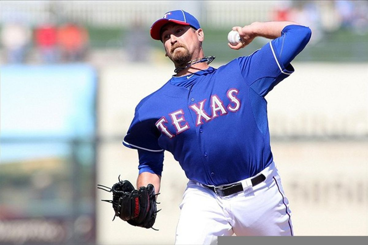 Mar 8, 2012; Surprise, AZ, USA; Texas Rangers relief pitcher Michael Kirkman (44) pitches against the Chicago White Sox during the third inning at Surprise Stadium.  Mandatory Credit: Jake Roth-US PRESSWIRE