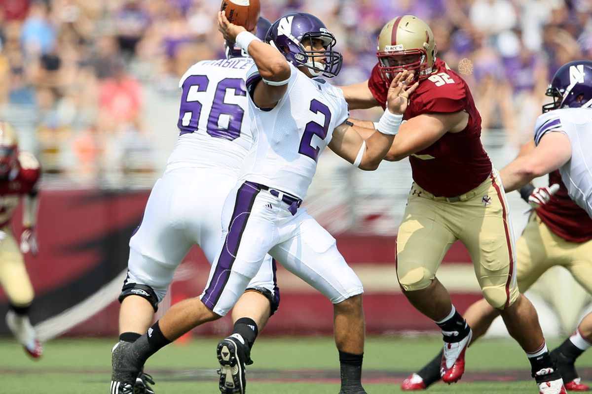 CHESTNUT HILL, MA - SEPTEMBER 03:  Kain Colter #2 of the Northwestern Wildcats looks to pass as Dillon Quinn#92 of the Boston College Eagles defends on September 3, 2011 at Alumni Stadium in Chestnut Hill, Massachusetts.  (Photo by Elsa/Getty Images)