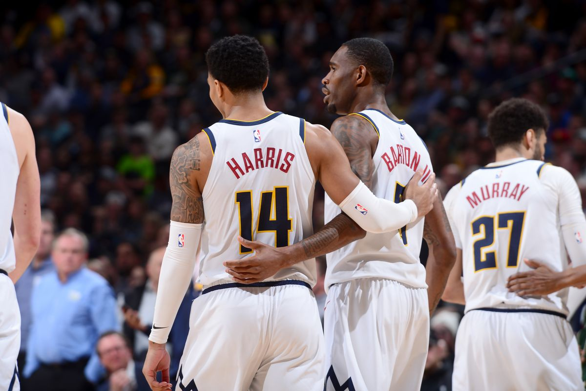 Gary Harris and Will Barton of the Denver Nuggets hug each other during the game against the Milwaukee Bucks on March 09, 2020 at the Pepsi Center in Denver, Colorado.