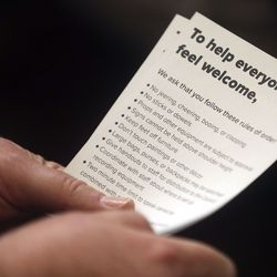An attendee holds a list of rules during a Salt Lake City Council Redevelopment Agency meetingat the City-County Building onTuesday, Aug. 20, 2019,regarding a proposed property tax increment reimbursement of up to $28 million for development of an inland port. Protesters were arrested at a previous meeting involving the inland port.
