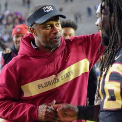 Willie Taggart celebrates with RS SR OL Arthur Williams after the win.
