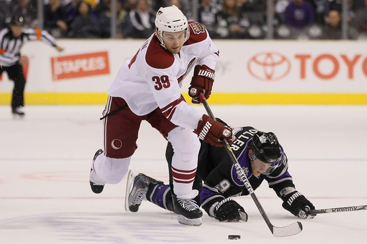 LOS ANGELES CA - SEPTEMBER 23:  Brett MacLean #39 of the Phoenix Coyotes skates past Oscar Moller #9 of the Los Angeles Kings in the first period at Staples Center on September 23 2010 in Los Angeles California.  (Photo by Jeff Gross/Getty Images)
