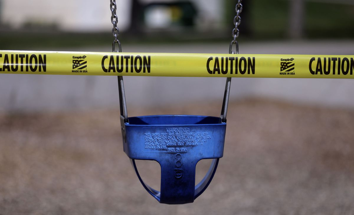 A swing on a playground is roped off with caution tape during the COVID-19pandemic in Salt Lake City on Wednesday, April 1, 2020.