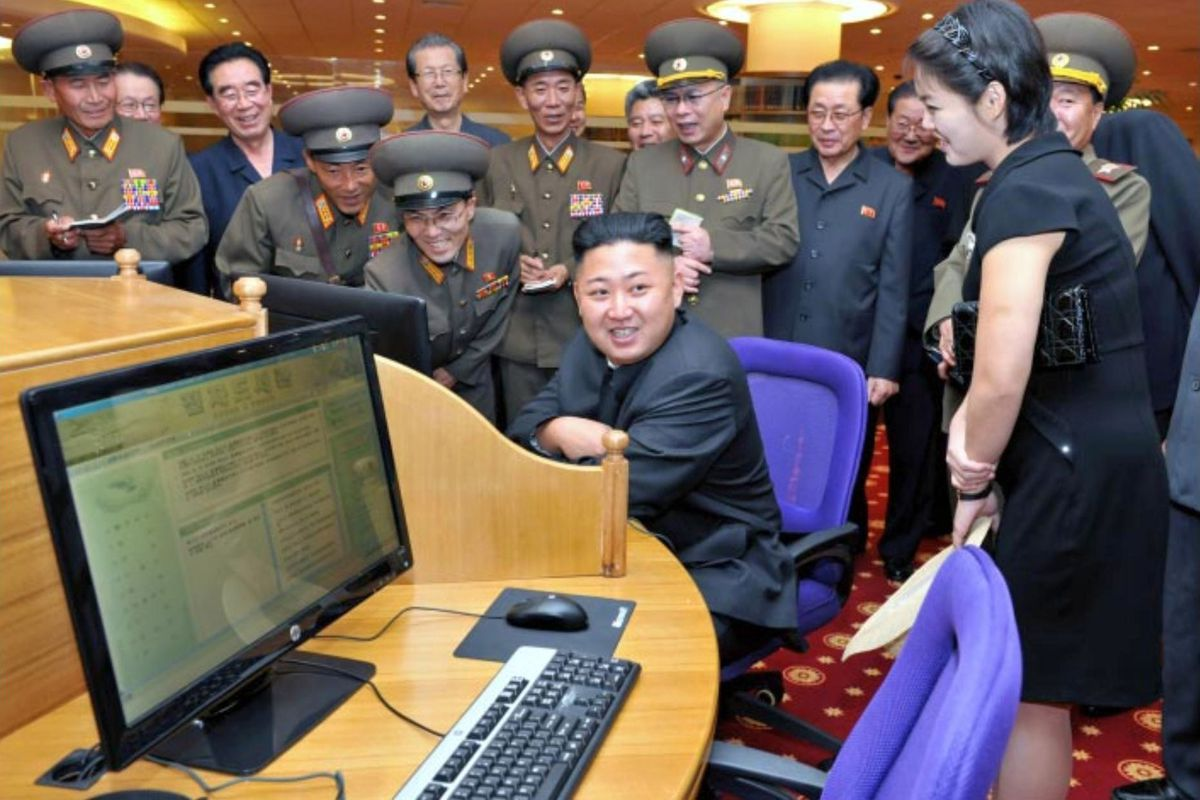 Kim Jong Un sits at a computer workstation at the E-Library at the KPA Exhibition of Arms and Equipment.