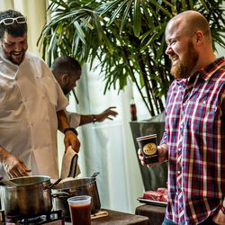 Kevin Gillespie (right) laughs with Kevin Rathbun before Sunday brunch during the Atlanta Food & Wine Festival.