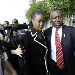 Sybrina Fulton, left, mother of Trayvon Martin and attorney Benjamin Crump, arrive at the Seminole County Criminal Justice Center for a bond hearing for George Zimmerman, the neighborhood watch volunteer charged with murdering Trayvon Martin, Friday, April 20, 2012, in Sanford, Fla.  Zimmerman's attorney is asking the Seminole County judge to let Zimmerman post bail at the hearing Friday.