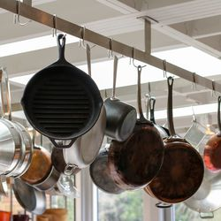 """""""You can tell by the copper pots it's a working kitchen,"""" Schwartz adds."""