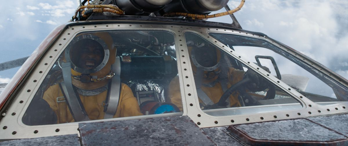Tej and Roman in their rocket-powered Pontiac as they attempt to head to outer space.
